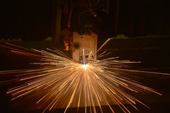 Industrial Laser cutting processing manufacture technology of flat sheet metal steel material with sparks Stock Photos
