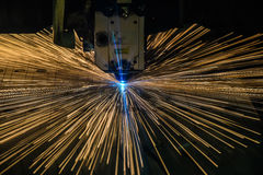 Industrial Laser cutting processing manufacture technology of flat sheet metal steel material with sparks Royalty Free Stock Photo