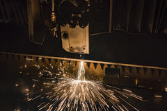 Industrial Laser cutting processing manufacture technology of flat sheet metal steel material with sparks. Laser cut metal splashes Royalty Free Stock Photography
