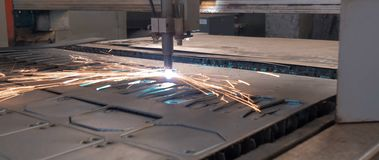 Laser cutting of metal sheet with sparks. stock photography