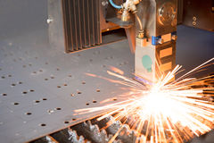 Industrial laser making holes in metal sheet Royalty Free Stock Photography