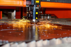 Industrial laser with sparks Stock Images