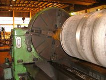 Industrial lathe manufacturing wind tower stock image