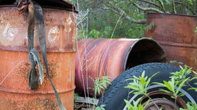 Industrial Leftovers. The juxtaposition of nature and manmade industrial trash speaks volumes Stock Photo