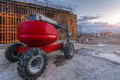 Industrial lifting platform in the construction of a wall stock photography