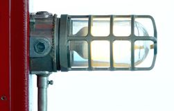 Industrial Light. Industrial-looking light fixture attached to a red post royalty free stock photos