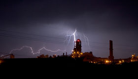 Industrial Lightning. Lightning over an industrial plant Stock Image