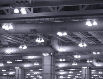 Industrial Lights On Commercial Building Ceiling Stock Images