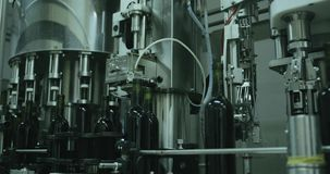 Industrial line of glass bottles, wine bottling equipment. 4k stock video footage