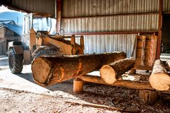 Industrial log loader operating at wood factory Stock Images