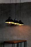 Industrial look pendant lamps in a Rustic Room. Royalty Free Stock Photography