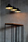 Industrial look pendant lamps in a Rustic Room Royalty Free Stock Image