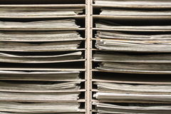 Industrial looking wooden rack with newspapers. Cool texture of newspapers on a wooden rack. Communications. Print industry. Commercial printing. Media. News Stock Images