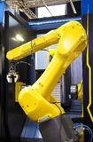 Industrial machine and factory robot arm,Smart factory industry 4.0 concept. A yellow robotic arm isolated on a blurry background Royalty Free Stock Image