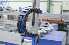 Industrial machine flexible power trak Stock Photography