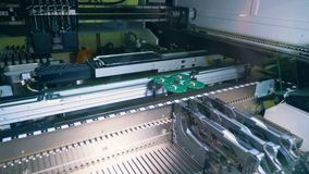 Industrial machine is manufacturing electronic boards