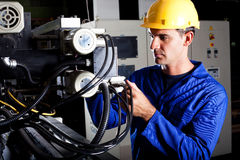 Industrial machine operator. Modern industrial machine operator working on machine Stock Images