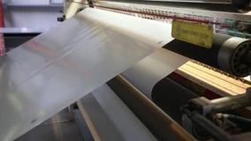 The industrial machine produces plastic foil
