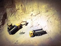 Industrial machine toys  on mountain background royalty free stock photography