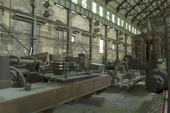 Industrial machinery. Antique industrial machinery in abandoned factory royalty free stock image