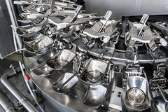 Industrial machinery for broken eggs 1. Industrial facility which automatically break the eggs and separate the whites from the yolks to pasteurization Stock Photography