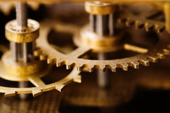 Industrial machinery bronze cog transmission macro view. Aged metal gear wheel teeth mechanism, shallow depth field