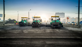 Industrial machines laying asphalt on new road Royalty Free Stock Photo