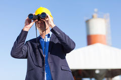 Industrial manager binoculars Stock Image