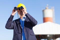 Industrial manager binoculars Stock Image