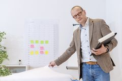Industrial Manager checking and planning stock image