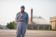 Industrial manufacturing factory worker posing. Industrial manufacturing factory worker stock image