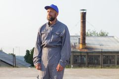 Industrial manufacturing factory worker posing. Industrial manufacturing factory worker royalty free stock photography
