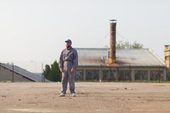 Industrial manufacturing factory worker posing in front of the factory. Industrial manufacturing factory worker posing royalty free stock photos