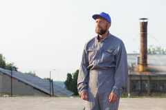 Industrial manufacturing factory worker posing in front of the factory. Industrial manufacturing factory worker posing royalty free stock photography