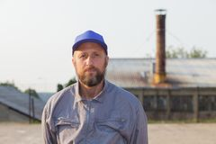 Industrial manufacturing factory worker posing. Portrait of an industrial manufacturing factory worker royalty free stock photography