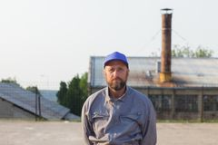 Industrial manufacturing factory worker posing. Portrait of an industrial manufacturing factory worker stock photos