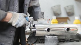 Industrial manufacturing. A man worker on fabric. Drilling the holes in iron pipe. Mid shot stock image