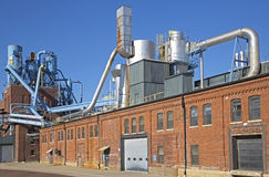 Industrial manufacturing plant on a sunny day. Royalty Free Stock Image