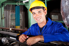 Industrial mechanic. Happy male industrial mechanic at work royalty free stock photos