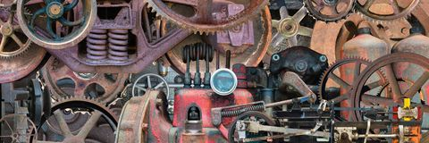 Industrial Mechanical Machine Parts Banner. Banner background of real industrial machine parts. Each part is from a vintage mechanical device and is covered with stock photography