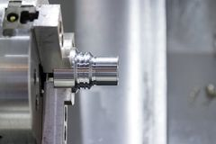 Industrial metal blank machining process by CNC lathe. In the industrial factory stock image