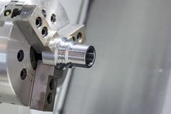 Industrial metal blank machining process by CNC lathe. In the industrial factory stock photos