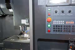 Industrial metal blank working on high precision CNC machine stock photos