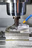 Industrial metal blank working on high precision CNC machine royalty free stock photo