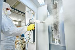 Industrial metal coating. Man in protective suit, wearing a gas royalty free stock photos
