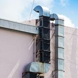 An Industrial metal exhaust vent outlet attached Royalty Free Stock Photos