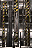 Industrial metal framework. A rendering of an abstract industrial metal framework with striped yellow and black safety markings stock images