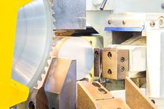 Industrial metal machining cutting process of blank. In the industrial factory stock photo