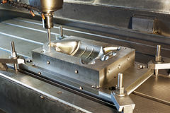 Industrial metal mold/blank milling. CNC technology. Stock Photography