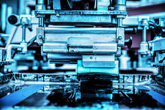 Industrial metal printing machinery. Royalty Free Stock Images